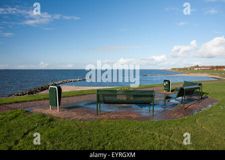 Picnic area with benches along the Dutch coast - Stock Photo