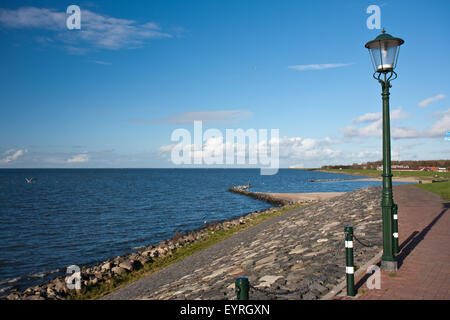 Seascape from Urk in the Netherlands at the windturbines along the coast - Stock Photo