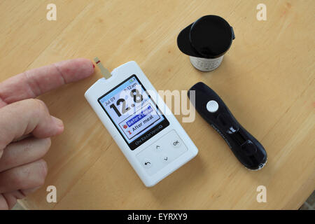 Glucose meter, diabetes, blood sugar monitoring, high blood sugar, hyperglucemia, - Stock Photo