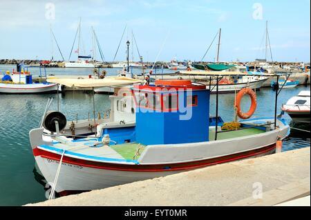 A colorful fishing boats on the island of Santorini Greece - Stock Photo