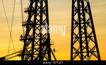 Workman on stairwell of Tees Transporter bridge, Middlesbrough, England, UK - Stock Photo