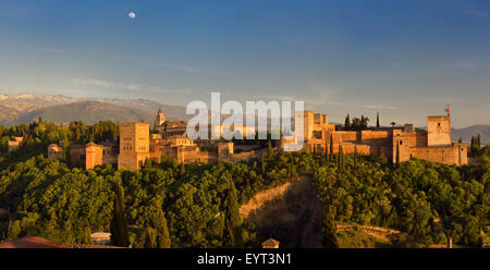 Panorama of hilltop Alhambra Palace fortress complex at sundown Granada - Stock Photo
