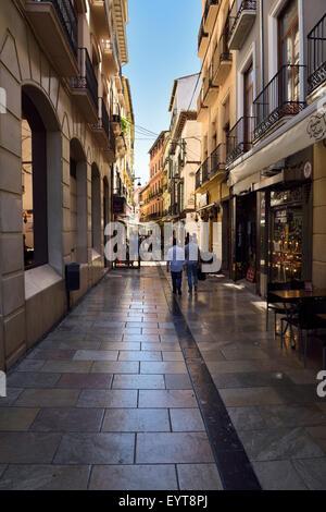 Pedestrians walking down Navas street to shops and restaurants in Granada Spain - Stock Photo