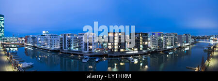 Germany, Hesse, Frankfurt am Main, modern luxury flatlets in the Westhafen (west harbour) by night, - Stock Photo