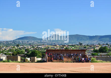 View of the city of Lubango, Angola, with a football stadium in the foreground - Stock Photo