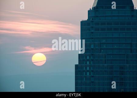 Germany, Hesse, Frankfurt am Main, Frankfurt Messeturm (Trade Fair Tower) in the sundown - Stock Photo