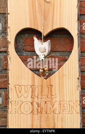 Sign 'Welcome' on exterior wall, heart, lettering, - Stock Photo