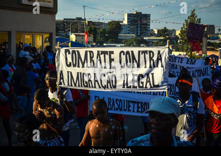 Carnival do Lubango, Angola (2014), a banner against illegal immigration - Stock Photo