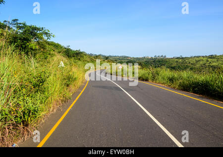 Brand new tar road in Angola in Cuanza Norte at sunset - Stock Photo