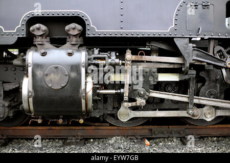 Close up of a cylinder, pistons, connecting rods and wheels on No 87 locomotive on the West Highland Railway line, - Stock Photo