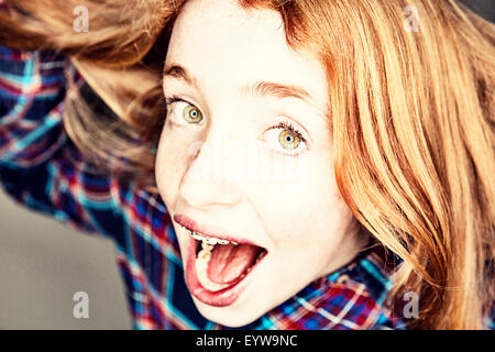 Naughty screaming red-haired girl, portrait - Stock Photo