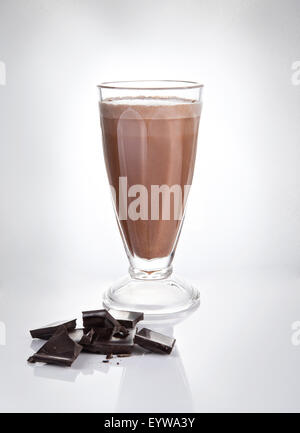 Chocolate milkshake in a tall glass with chocolate chips - Stock Photo