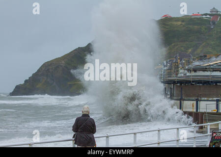 Aberystwyth, Wales, UK. 4 August 2015. Stormy Weather. A 5-8 ft swell, high winds and a high tide cmbine to lash - Stock Photo