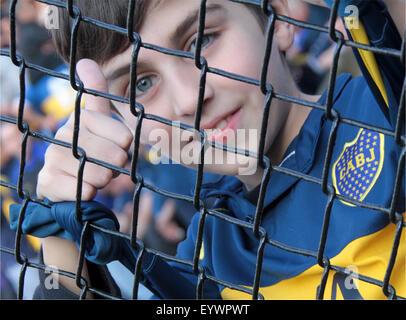 BUENOS AIRES, 02.08.2015 - BOCA JUNIORS  X UNION SANTA FE - A boy fan of Boca during  the game in La Bombonera. - Stock Photo