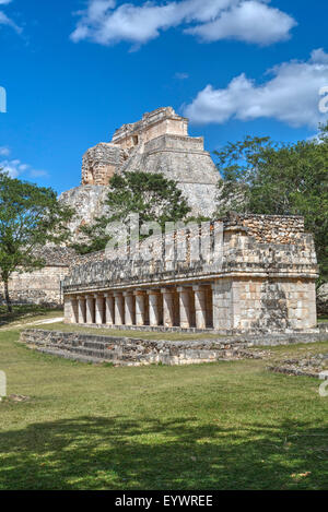 Columns Building in foreground with Pyramid of the Magician beyond, Uxmal, Mayan archaeological site, UNESCO, Yucatan, - Stock Photo