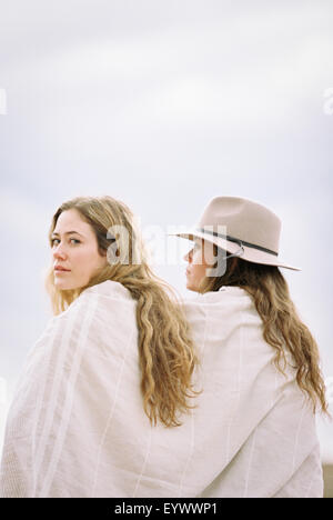 Two women one looking over her shoulder - Stock Photo