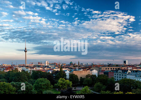 Berlin sunset view from apartment building rooftop. Dramatic evening landscape view of German capital city - Stock Photo