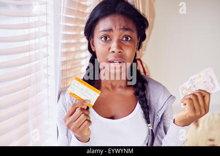 Girl worried about expensive train tickets - Stock Photo