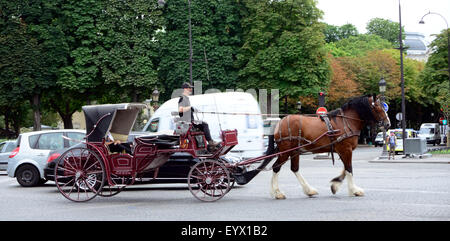 A horse and carriage ride along the Champs Elysees in Paris. - Stock Photo