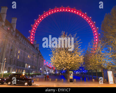 London Taxi and The London Eye at dusk with new 2015 'Coca Cola' sponsorship colour South Bank London, England UK - Stock Photo