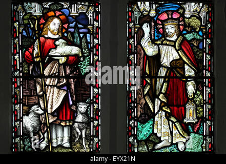 Stained Glass Window depicting 'The Good Shepherd' and 'The Light Of The World' - Stock Photo