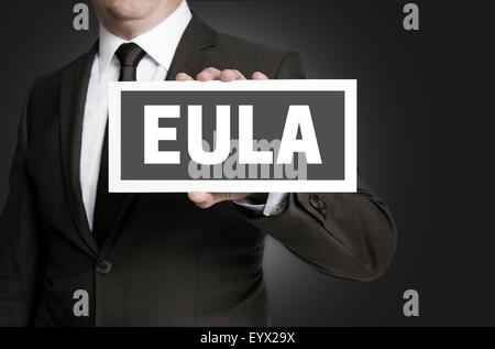Eula sign is held by businessman. - Stock Photo