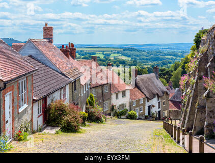 Gold Hill with the old abbey walls to the right, Shaftesbury, Dorset, England, UK - Stock Photo