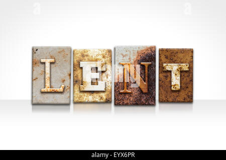 The word 'LENT' written in rusty metal letterpress type isolated on a white background. - Stock Photo