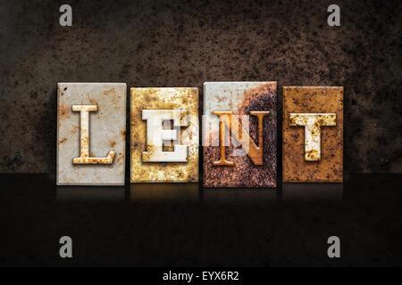 The word 'LENT' written in rusty metal letterpress type on a dark textured grunge background.