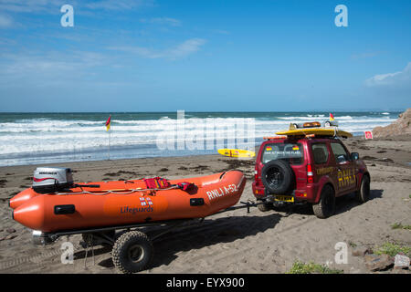 Surf lifesaving, warning flags and equipment on beach ready for use by RNLI lifeguards - Stock Photo