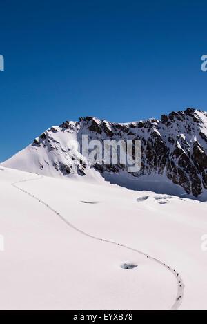 Walking trail up the Aletsch glacier from Jungfraujoch to Mönchsjoch Hutte - Stock Photo