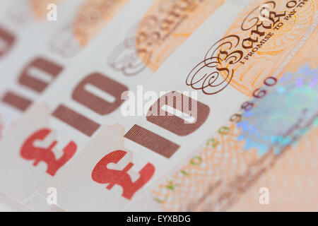 Background of ten UK pound bank notes (sterling) - Stock Photo
