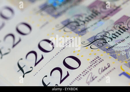 Background of British twenty UK pound bank notes sterling - Stock Photo