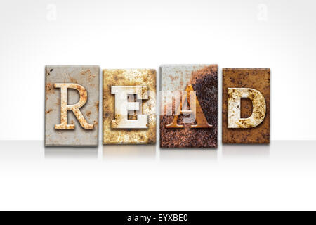 The word 'READ' written in rusty metal letterpress type isolated on a white background. - Stock Photo