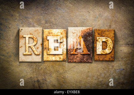 The word 'READ' written in rusty metal letterpress type on an old aged leather background. - Stock Photo