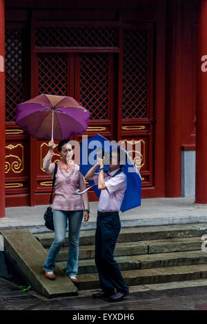 A Chinese Tourist Taking Photos At The Lama Temple (Yong He Gong) Beijing, China - Stock Photo