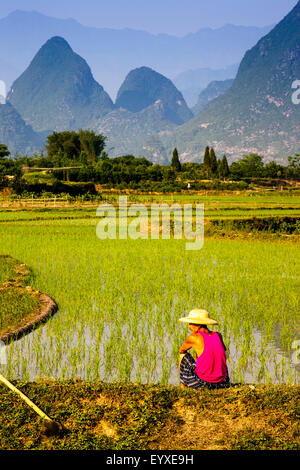 A Local Man Takes A Break From Working In The Rice Fields, Yangshuo, Guangxi Province, China - Stock Photo