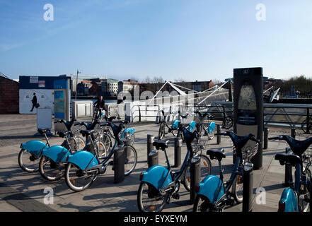 Sean O'Casey Bridge with the Dublin ' bike sharing scheme' park in the foregrond, Dublin City, Ireland - Stock Photo