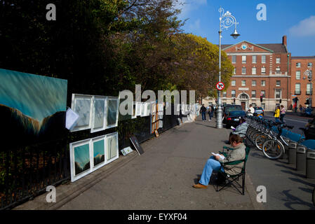 Art Exhibition on the railings of Merrion Square, with Holles Street Maternity Hospital Behind, Dublin City, Ireland - Stock Photo