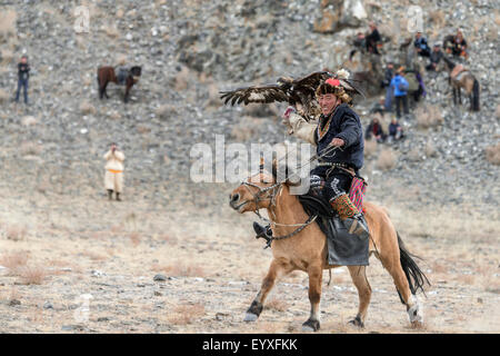 Golden eagle returns to its handler 1, Eagle Festival, Olgii, Western Mongolia - Stock Photo