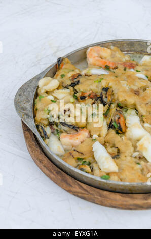 Fried seafood pancakes in hot plate, Thai style. - Stock Photo