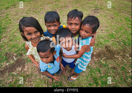 Small children hugging each other, Lonthor, Banda, Moluccas, Indonesia - Stock Photo