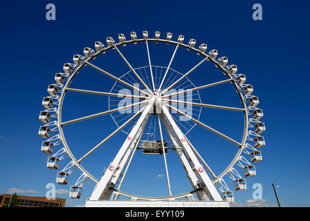 Ferris wheel at Strandkai in the harbor city, Hamburg, Germany - Stock Photo
