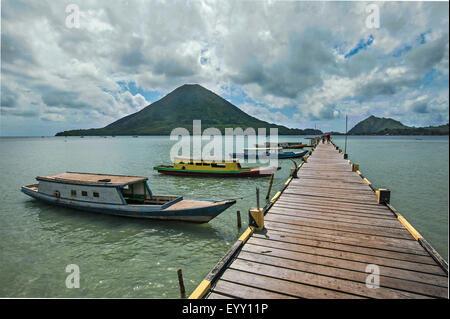 Jetty of Lonthor, the volcano Gunung Api behind, Banda Islands, Moluccas, Indonesia - Stock Photo