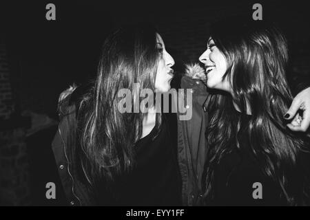 Smiling women laughing at party