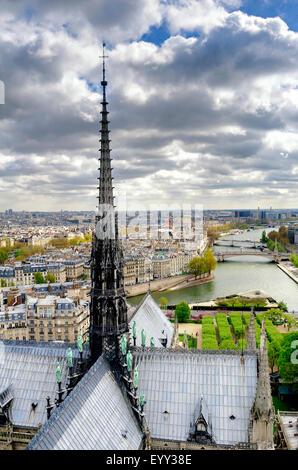 Notre Dame spire over Paris cityscape, Ile-de-France, France - Stock Photo