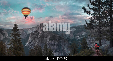 Hot air balloon floating over dramatic mountains, Richmond, Virginia, United States - Stock Photo