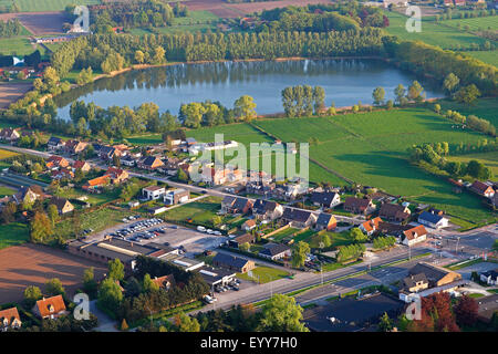 lake, urbanisation at the border of agricultural area from the air, Belgium - Stock Photo