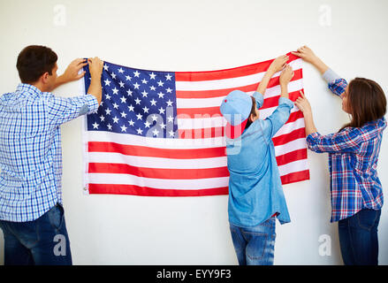 Hanging Flag On Wall american flag hanging on a a wall stock photo, royalty free image