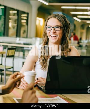Business people working together in cafe - Stock Photo